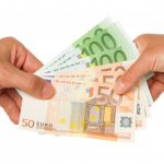 Man giving 450 euro to a woman, isolated on white